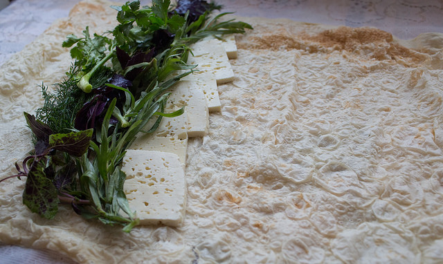Ready to wrap: Lavash bread with herbs and salty cheese. Photo: Raffi Youredjian