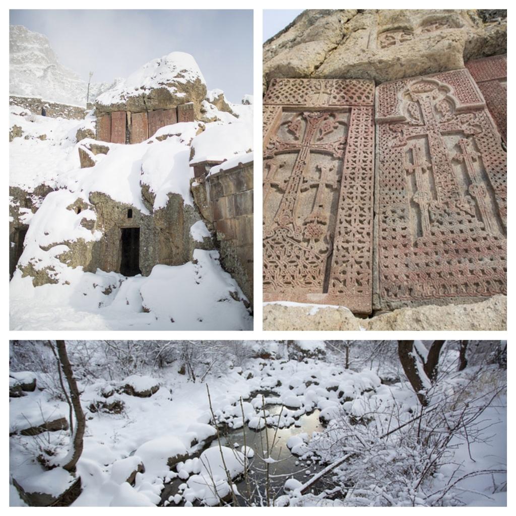 Geghard Monastery built into rock mountain on a cliff. A mineral spring runs through the complex.
